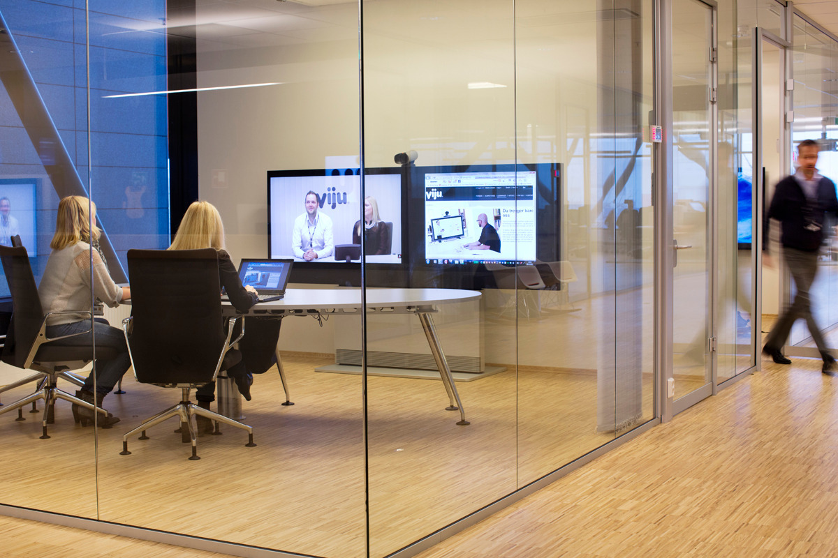 Duel Screen Conference Call in a Glass Meeting Room